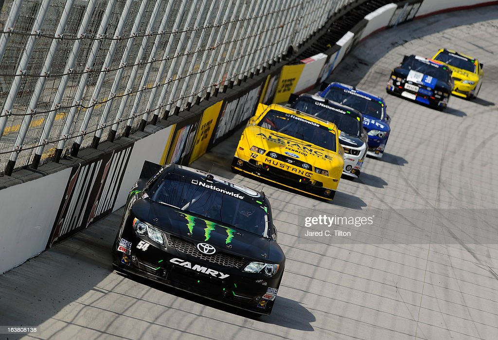 Kyle Busch, driver of the #54 Monster Energy Toyota, leads a group of cars into turn three during the NASCAR Nationwide Series Jeff Foxworthy's Grit Chips 300 at Bristol Motor Speedway on March 16, 2013 in Bristol, Tennessee.