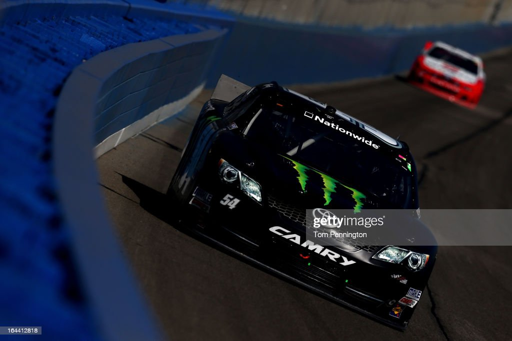 <a gi-track='captionPersonalityLinkClicked' href=/galleries/search?phrase=Kyle+Busch&family=editorial&specificpeople=211123 ng-click='$event.stopPropagation()'>Kyle Busch</a>, driver of the #54 Monster Energy Toyota, leads <a gi-track='captionPersonalityLinkClicked' href=/galleries/search?phrase=Sam+Hornish+Jr.&family=editorial&specificpeople=176571 ng-click='$event.stopPropagation()'>Sam Hornish Jr.</a>, driver of the #12 Wurth Ford, during the NASCAR Nationwide Series Royal Purple 300 at Auto Club Speedway on March 23, 2013 in Fontana, California.