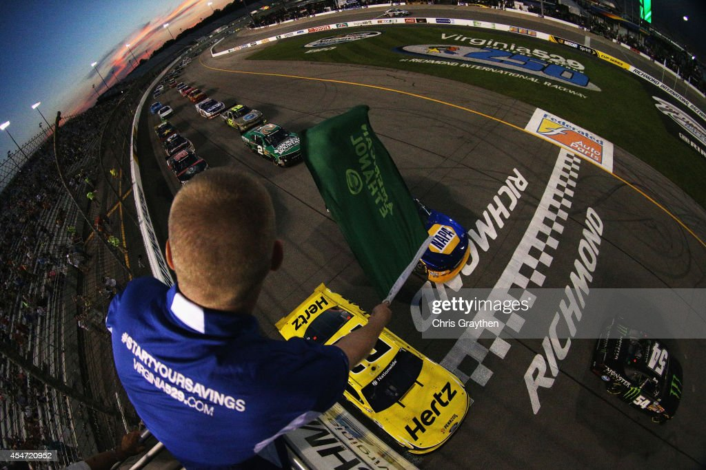 Kyle Busch driver of the Monster Energy Toyota leads the field past the green flag to start the NASCAR Nationwide Series Virginia529 College Savings...