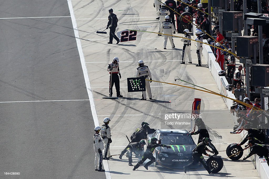 <a gi-track='captionPersonalityLinkClicked' href=/galleries/search?phrase=Kyle+Busch&family=editorial&specificpeople=211123 ng-click='$event.stopPropagation()'>Kyle Busch</a>, driver of the #54 Monster Energy Toyota, pits during the NASCAR Nationwide Series Royal Purple 300 at Auto Club Speedway on March 23, 2013 in Fontana, California.