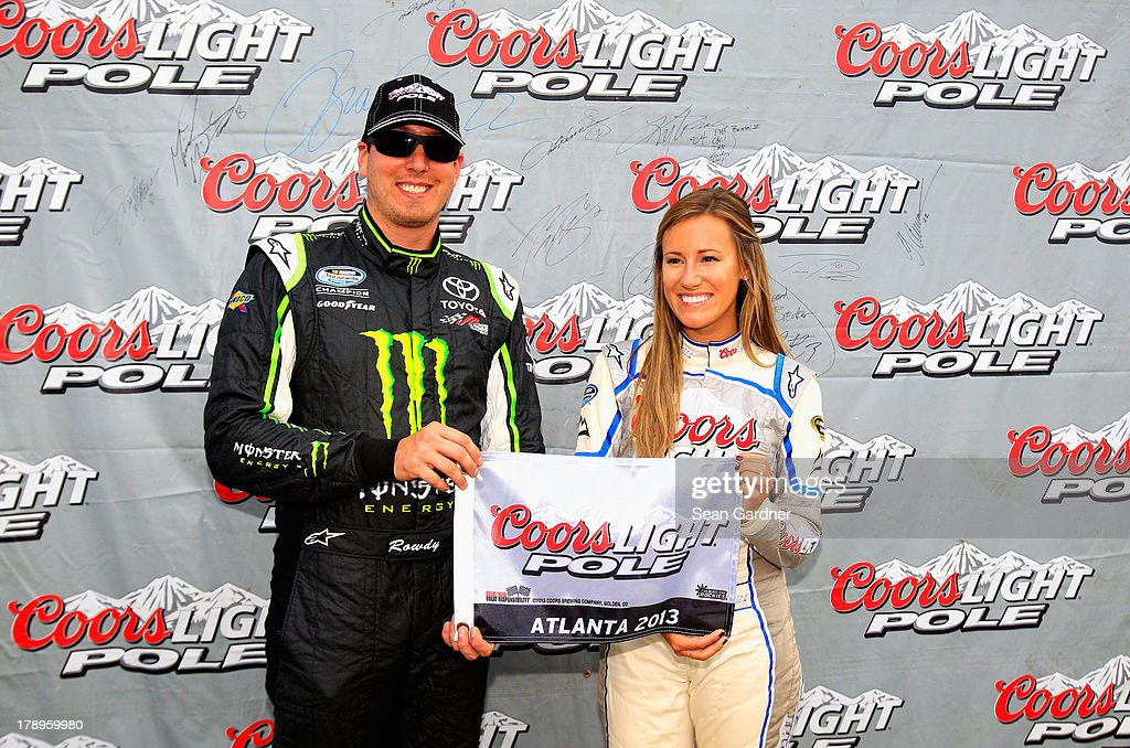 <a gi-track='captionPersonalityLinkClicked' href=/galleries/search?phrase=Kyle+Busch&family=editorial&specificpeople=211123 ng-click='$event.stopPropagation()'>Kyle Busch</a>, driver of the #54 Monster Energy Toyota, poses with Miss Coors Light Rachel Rupert and the Coors Light pole award after posting the fastest lap during qualifying for the NASCAR Nationwide Series Great Clips/Grit Chips 300 at Atlanta Motor Speedway on August 31, 2013 in Hampton, Georgia.
