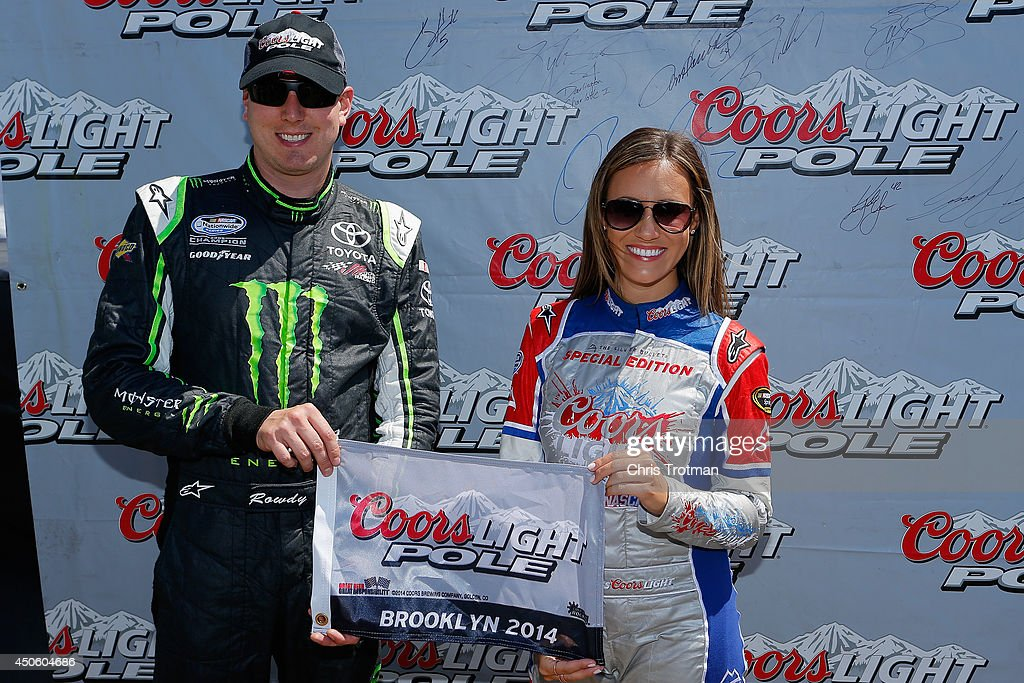Kyle Busch (left), driver of the #54 Monster Energy Toyota, poses with Miss Coors Light Rachel Rupert and the Coors Light Pole Award after qualifying for the pole for the NASCAR Nationwide Series Ollie's Bargain Outlet 250 at Michigan International Speedway on June 14, 2014 in Brooklyn, Michigan.