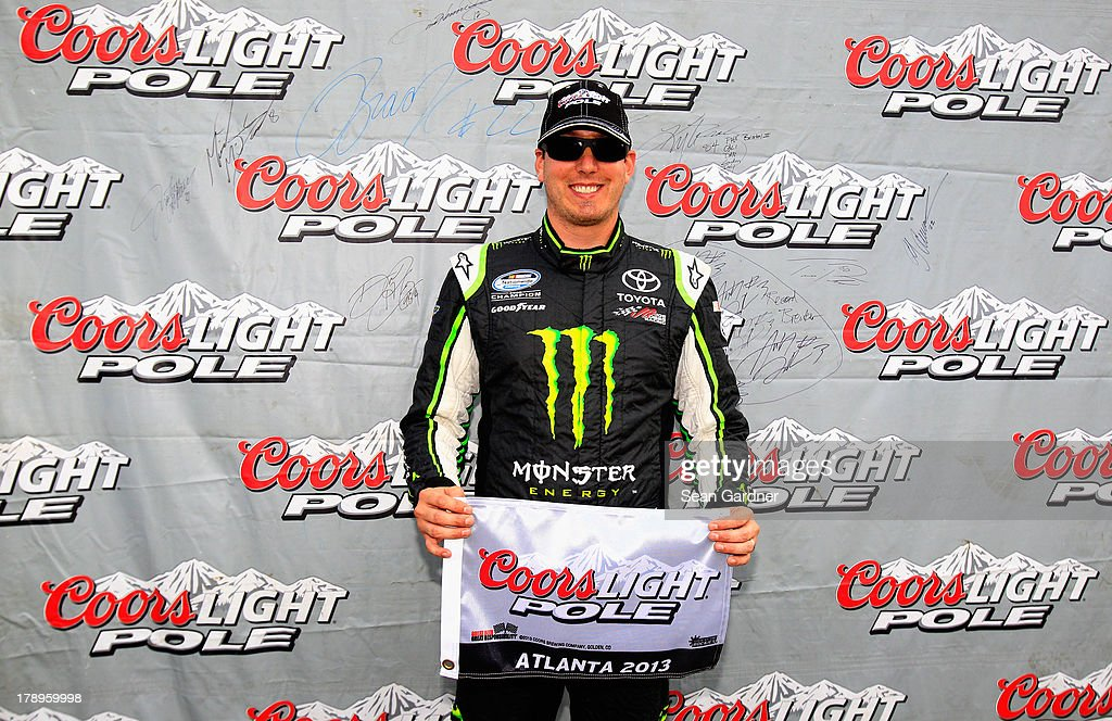 Kyle Busch, driver of the #54 Monster Energy Toyota, poses with the Coors Light pole award after posting the fastest lap during qualifying for the NASCAR Nationwide Series Great Clips/Grit Chips 300 at Atlanta Motor Speedway on August 31, 2013 in Hampton, Georgia.