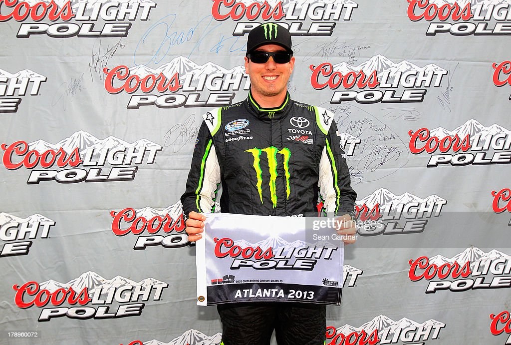 <a gi-track='captionPersonalityLinkClicked' href=/galleries/search?phrase=Kyle+Busch&family=editorial&specificpeople=211123 ng-click='$event.stopPropagation()'>Kyle Busch</a>, driver of the #54 Monster Energy Toyota, poses with the Coors Light pole award after posting the fastest lap during qualifying for the NASCAR Nationwide Series Great Clips/Grit Chips 300 at Atlanta Motor Speedway on August 31, 2013 in Hampton, Georgia.