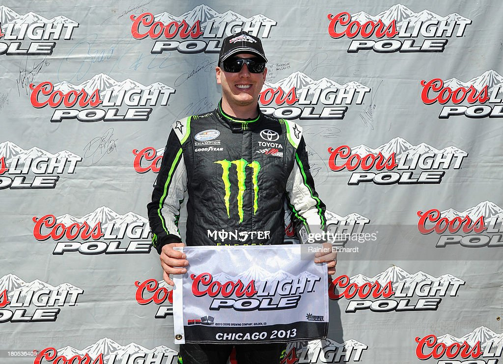 Kyle Busch, driver of the #54 Monster Energy Toyota, poses with the Coor's Light pole award after qualifying for pole position for the NASCAR Nationwide Series Dollar General 300 Powered by Coca-Cola at Chicagoland Speedway on September 14, 2013 in Joliet, Illinois.