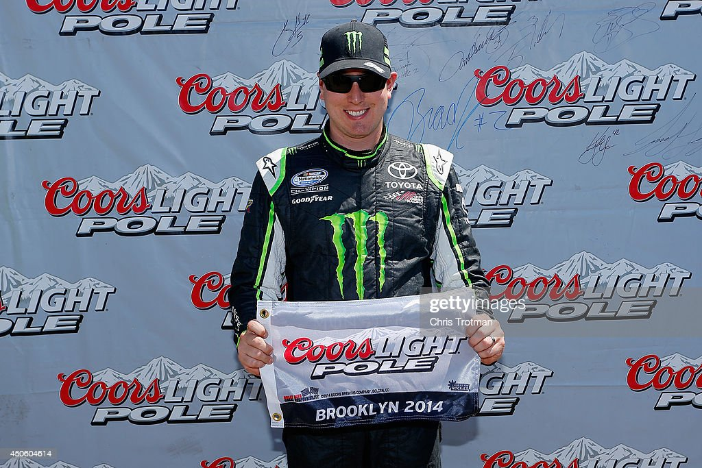 <a gi-track='captionPersonalityLinkClicked' href=/galleries/search?phrase=Kyle+Busch&family=editorial&specificpeople=211123 ng-click='$event.stopPropagation()'>Kyle Busch</a>, driver of the #54 Monster Energy Toyota, poses with the Coors Light Pole Award after qualifying for the pole for the NASCAR Nationwide Series Ollie's Bargain Outlet 250 at Michigan International Speedway on June 14, 2014 in Brooklyn, Michigan.
