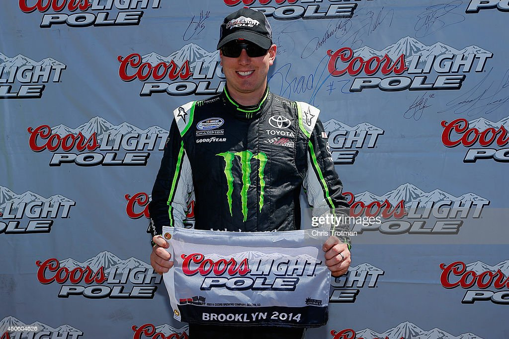 Kyle Busch, driver of the #54 Monster Energy Toyota, poses with the Coors Light Pole Award after qualifying for the pole for the NASCAR Nationwide Series Ollie's Bargain Outlet 250 at Michigan International Speedway on June 14, 2014 in Brooklyn, Michigan.
