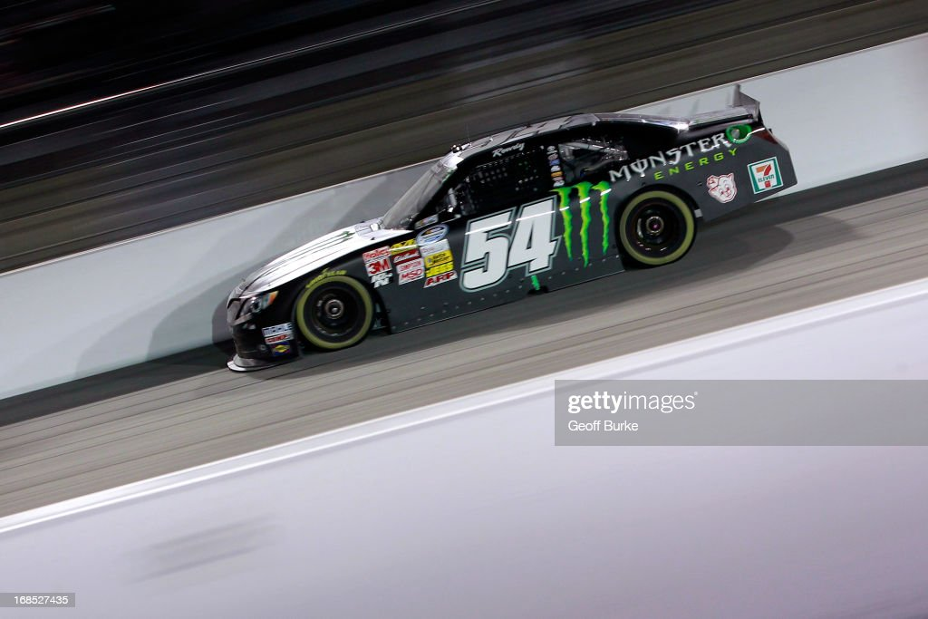 <a gi-track='captionPersonalityLinkClicked' href=/galleries/search?phrase=Kyle+Busch&family=editorial&specificpeople=211123 ng-click='$event.stopPropagation()'>Kyle Busch</a>, driver of the #54 Monster Energy Toyota, races during the NASCAR Nationwide Series VFW Sport Clips Help A Hero 200 at Darlington Raceway on May 10, 2013 in Darlington, South Carolina.