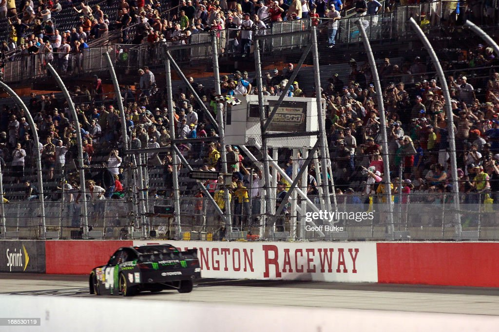Kyle Busch, driver of the #54 Monster Energy Toyota, takes the checkered flag to win the NASCAR Nationwide Series VFW Sport Clips Help A Hero 200 at Darlington Raceway on May 10, 2013 in Darlington, South Carolina.