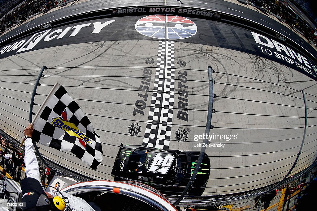 Kyle Busch, driver of the #54 Monster Energy Toyota, takes the checkered flag to win the NASCAR Nationwide Series Drive To Stop Diabetes 300 at Bristol Motor Speedway on March 15, 2014 in Bristol, Tennessee.