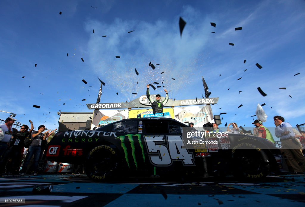 <a gi-track='captionPersonalityLinkClicked' href=/galleries/search?phrase=Kyle+Busch&family=editorial&specificpeople=211123 ng-click='$event.stopPropagation()'>Kyle Busch</a>, driver of the #54 Monster Toyota, celebrates in victory lane during the NASCAR Nationwide Series Dollar General 200 fueled by AmeriGas at Phoenix International Raceway on March 2, 2013 in Avondale, Arizona.