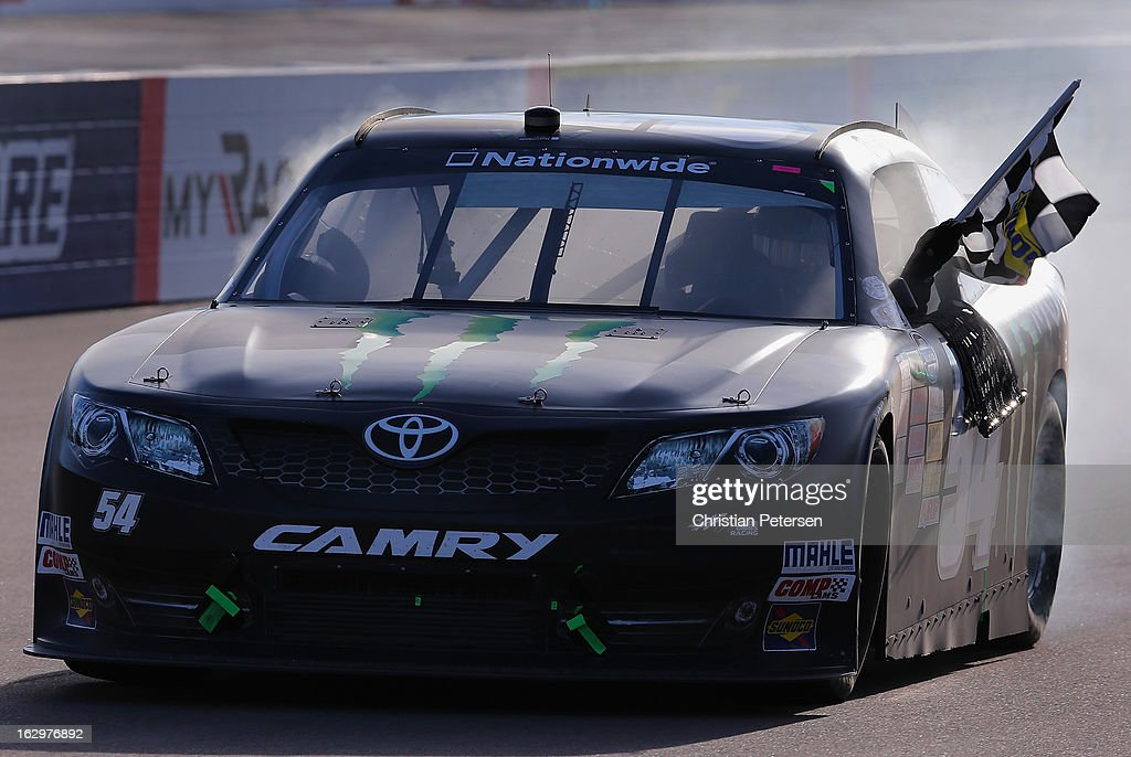 <a gi-track='captionPersonalityLinkClicked' href=/galleries/search?phrase=Kyle+Busch&family=editorial&specificpeople=211123 ng-click='$event.stopPropagation()'>Kyle Busch</a>, driver of the #54 Monster Toyota, performs a burn out to celebrate winning the NASCAR Nationwide Series Dollar General 200 fueled by AmeriGas at Phoenix International Raceway on March 2, 2013 in Avondale, Arizona.