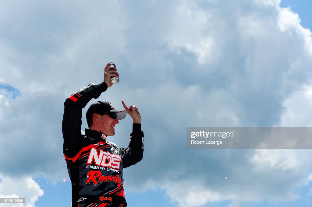 Kyle Busch, driver of the #18 NOS Energy Drink Rowdy Toyota, celebrates in Victory Lane after winning the NASCAR XFINITY Series Alsco 300 at Kentucky Speedway on July 8, 2017 in Sparta, Kentucky.