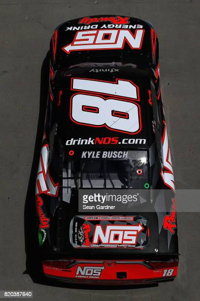 Kyle Busch driver of the NOS Energy Drink Rowdy Toyota drives through the garage area during practice for the NASCAR XFINITY Series Lilly Diabetes...