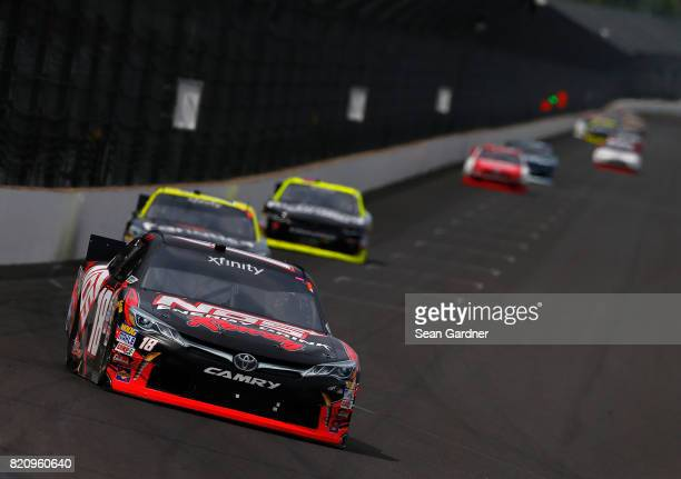 Kyle Busch driver of the NOS Energy Drink Rowdy Toyota leads a pack of cars during the NASCAR XFINITY Series Lilly Diabetes 250 at Indianapolis...