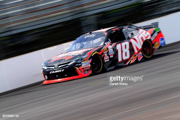 Kyle Busch driver of the NOS Energy Drink Rowdy Toyota races during the NASCAR XFINITY Series Lilly Diabetes 250 at Indianapolis Motorspeedway on...