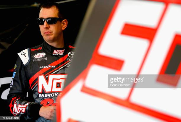 Kyle Busch driver of the NOS Energy Drink Rowdy Toyota stands in the garage during practice for the NASCAR XFINITY Series Lilly Diabetes 250 at...
