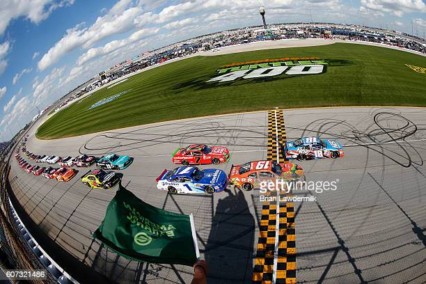 Kyle Busch driver of the NOS Energy Drink Toyota and Daniel Suarez driver of the ARRIS/TMNT Michelangelo Toyota lead the field to start the NASCAR...