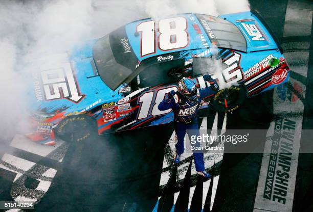 Kyle Busch driver of the NOS Energy Drink Toyota celebrates after winning the NASCAR XFINITY Series Overton's 200 at New Hampshire Motor Speedway on...