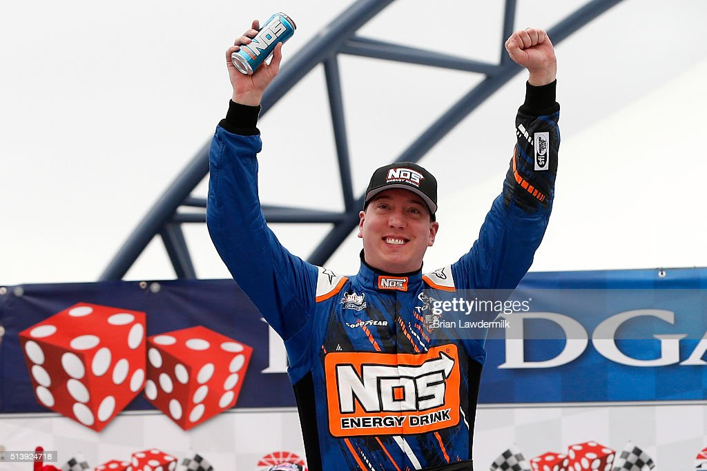Kyle Busch driver of the NOS Energy Drink Toyota celebrates in Victory Lane after winning the NASCAR Xfinity Series Boyd Gaming 300 at Las Vegas...
