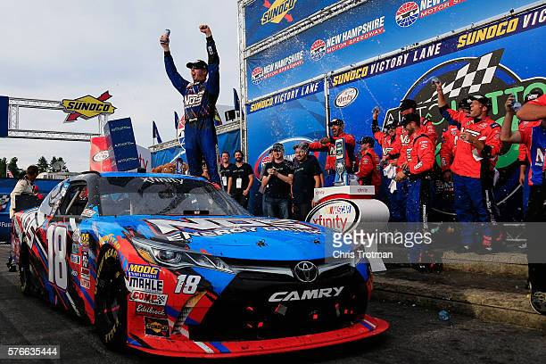 Kyle Busch driver of the NOS Energy Drink Toyota celebrates in Victory Lane after winning the NASCAR XFINITY Series AutoLotto 200 at New Hampshire...