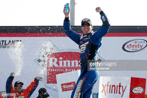 Kyle Busch driver of the NOS Energy Drink Toyota celebrates in Victory Lane after winning the NASCAR XFINITY Series Rinnai 250 at Atlanta Motor...