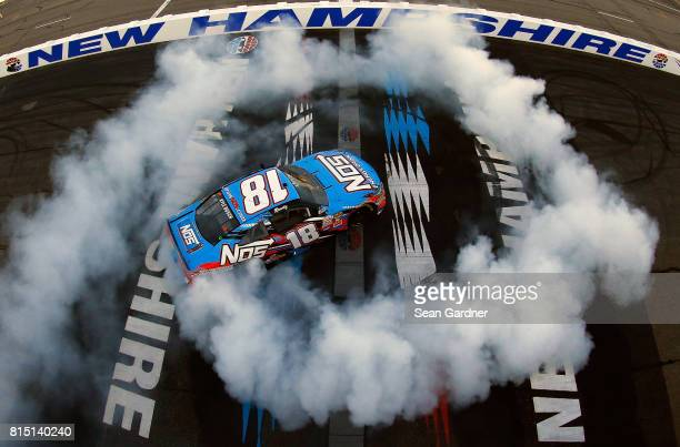 Kyle Busch driver of the NOS Energy Drink Toyota celebrates with a burnout after winning the NASCAR XFINITY Series Overton's 200 at New Hampshire...