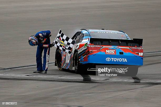 Kyle Busch driver of the NOS Energy Drink Toyota celebrates with the checkered flag after winning the NASCAR Xfinity Series Boyd Gaming 300 at Las...