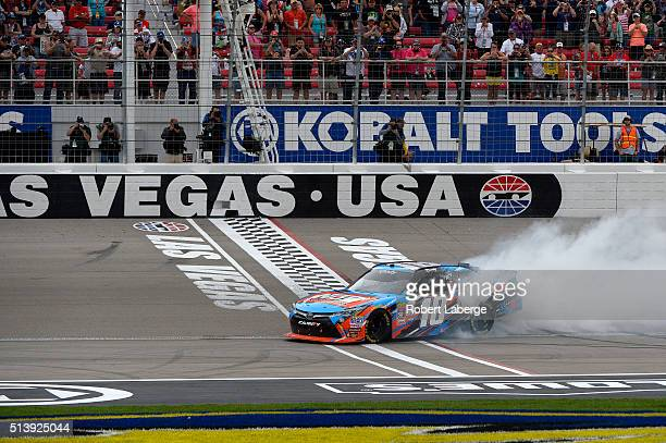 Kyle Busch driver of the NOS Energy Drink Toyota does a burnout after winning the NASCAR Xfinity Series Boyd Gaming 300 at Las Vegas Motor Speedway...