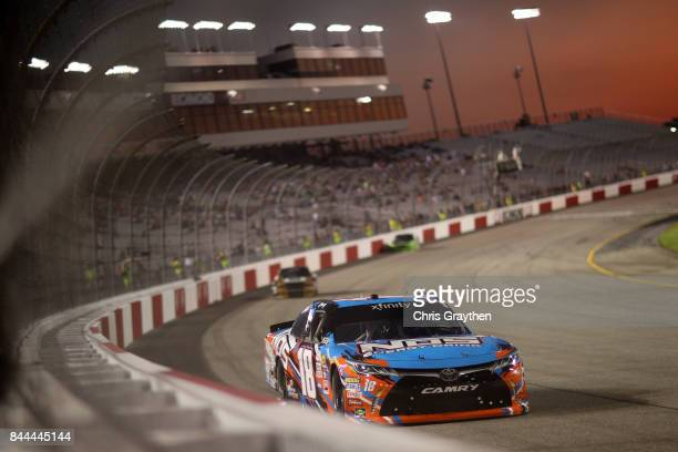 Kyle Busch driver of the NOS Energy Drink Toyota leads a pack of cars during the NASCAR XFINITY Series Virginia529 College Savings 250 at Richmond...