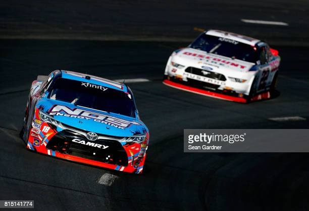 Kyle Busch driver of the NOS Energy Drink Toyota leads Brad Keselowski driver of the Discount Tire Ford during the NASCAR XFINITY Series Overton's...