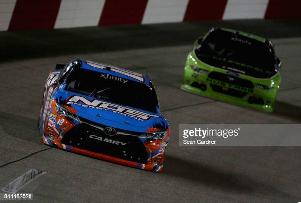 Kyle Busch driver of the NOS Energy Drink Toyota leads Brad Keselowski driver of the Fitzgerald Glider Kits Ford during the NASCAR XFINITY Series...