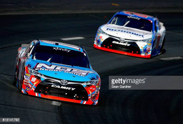 Kyle Busch driver of the NOS Energy Drink Toyota leads Ryan Preece driver of the MoHawk Northeast Inc Toyota during the NASCAR XFINITY Series...