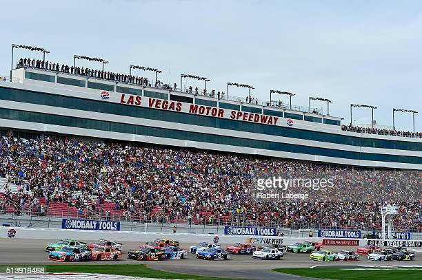 Kyle Busch driver of the NOS Energy Drink Toyota leads the field at the start of the NASCAR Xfinity Series Boyd Gaming 300 at Las Vegas Motor...
