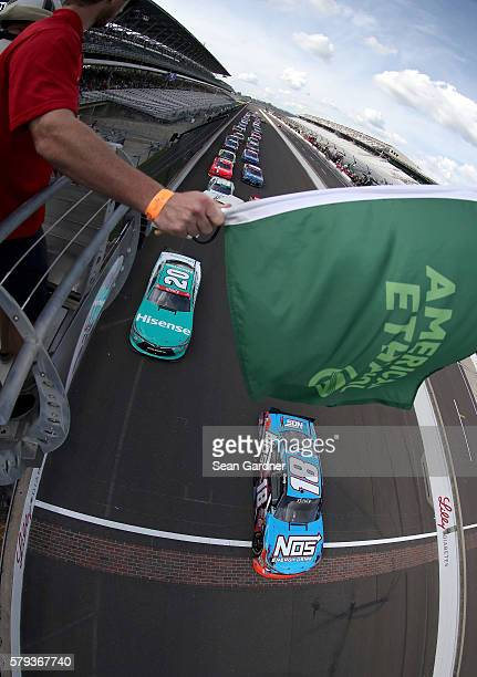 Kyle Busch driver of the NOS Energy Drink Toyota leads the field past the green flag to start the NASCAR XFINITY Series Lilly Diabetes 250 at...