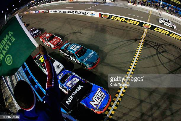 Kyle Busch driver of the NOS Energy Drink Toyota leads the field past the green flag to start the NASCAR XFINITY Series Ticket Galaxy 200 at Phoenix...