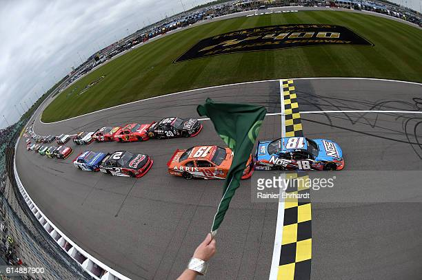 Kyle Busch driver of the NOS Energy Drink Toyota leads the field to the green flag to start the NASCAR XFINITY Series Kansas Lottery 300 at Kansas...