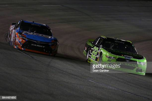 Kyle Busch driver of the NOS Energy Drink Toyota races Brad Keselowski driver of the Fitzgerald Glider Kits Ford during the NASCAR XFINITY Series...