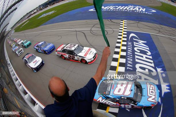 Kyle Busch driver of the NOS Energy Drink Toyota takes the green flag at the start of the NASCAR XFINITY Series Irish Hills 250 at Michigan...