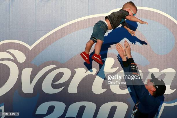 Kyle Busch driver of the NOS Energy Drink Toyota tosses his son Brexton into the air in Victory Lane after winning the NASCAR XFINITY Series...