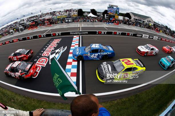 Kyle Busch driver of the NOS Rowdy Toyota and Joey Logano driver of the SnapOn Ford lead the field to the green flag to start the NASCAR XFINITY...