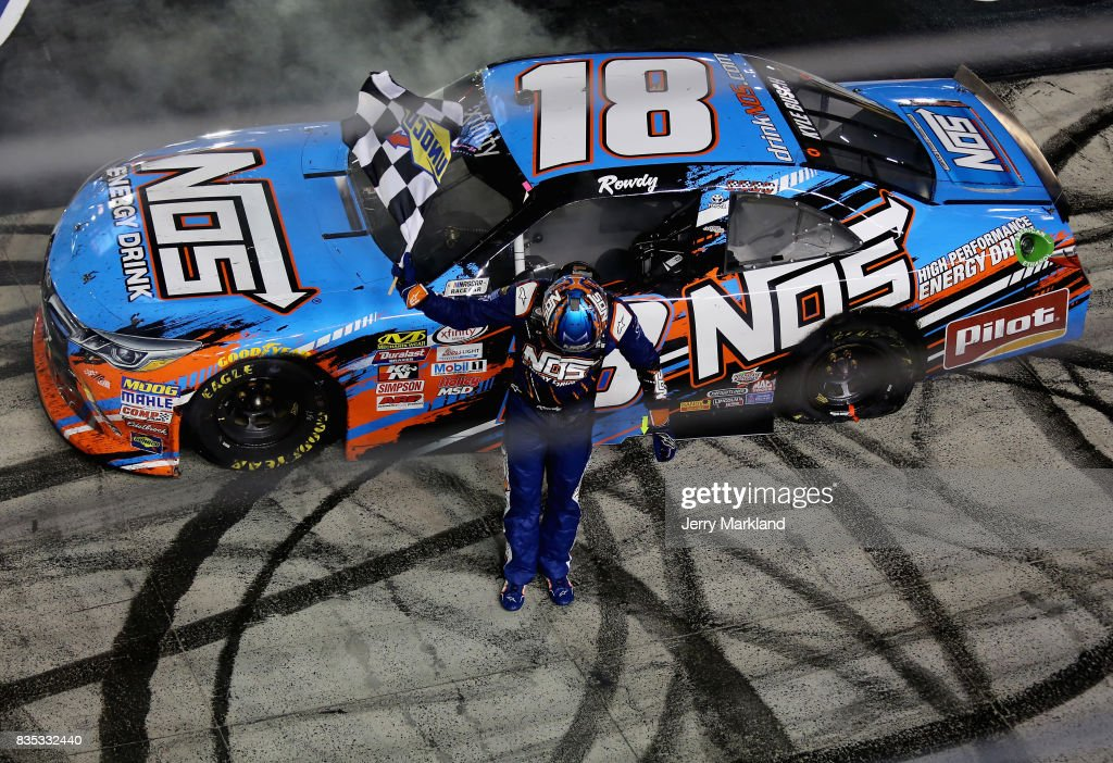 Kyle Busch, driver of the #18 NOS Rowdy Toyota, celebrates with the checkered flag after winning the NASCAR XFINITY Series Food City 300 at Bristol Motor Speedway on August 18, 2017 in Bristol, Tennessee.