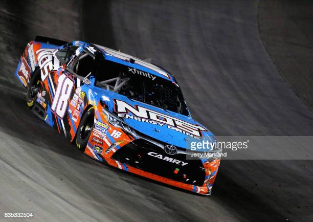 Kyle Busch driver of the NOS Rowdy Toyota leads a pack of cars during the NASCAR XFINITY Series Food City 300 at Bristol Motor Speedway on August 18...