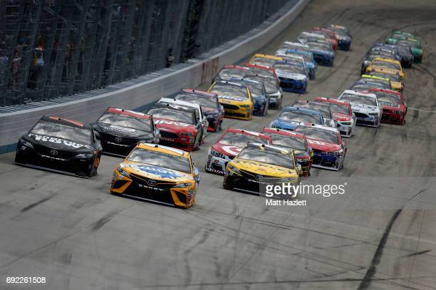 Kyle Busch driver of the Pedigree Petcare Toyota and Martin Truex Jr driver of the Furniture Row/Denver Mattress Toyota lead the field to start the...