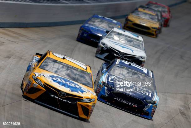 Kyle Busch driver of the Pedigree Petcare Toyota leads a pack of cars during the Monster Energy NASCAR Cup Series AAA 400 Drive for Autism at Dover...
