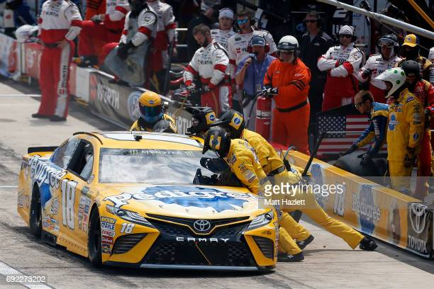 Kyle Busch driver of the Pedigree Petcare Toyota pits during the Monster Energy NASCAR Cup Series AAA 400 Drive for Autism at Dover International...