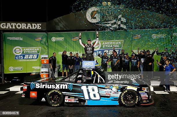 Kyle Busch driver of the SiriusXM Toyota celebrates in Victory Lane after winning the NASCAR Camping World Truck Series American Ethanol E15 225 at...