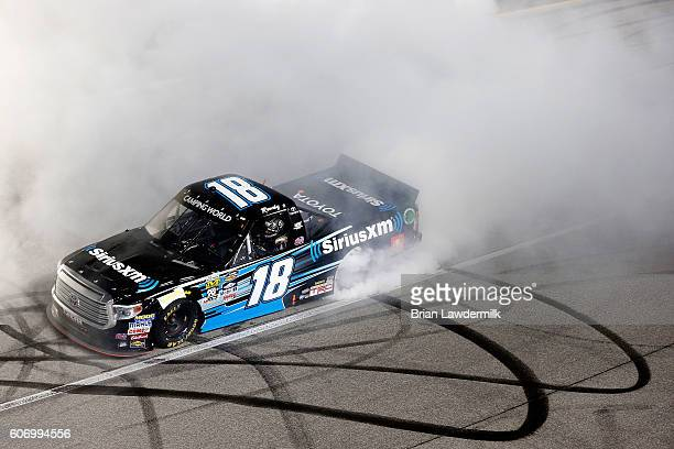 Kyle Busch driver of the SiriusXM Toyota celebrates with a burnout after winning the NASCAR Camping World Truck Series American Ethanol E15 225 at...