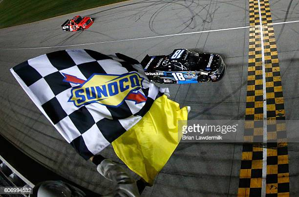 Kyle Busch driver of the SiriusXM Toyota crosses the finishline to win the NASCAR Camping World Truck Series American Ethanol E15 225 at Chicagoland...