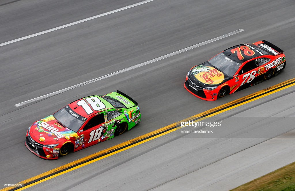 <a gi-track='captionPersonalityLinkClicked' href=/galleries/search?phrase=Kyle+Busch&family=editorial&specificpeople=211123 ng-click='$event.stopPropagation()'>Kyle Busch</a>, driver of the #18 Skittles Marvel Toyota, leads Martin Truex Jr, driver of the #78 Bass Pro Shops/TRACKER Boats Toyota, during the NASCAR Sprint Cup Series GEICO 500 at Talladega Superspeedway on May 1, 2016 in Talladega, Alabama.